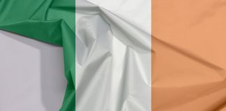 Ireland fabric flag crepe and crease with white space. Ireland fabric flag crepe and crease with white space, a vertical tricolor of green, white and orange royalty free stock photo