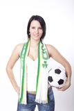 Ireland fan. Girl holding scarf of Ireland and football Stock Images