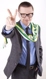 Ireland fan. Young man holding Ireland flag showing victory sign Royalty Free Stock Photography