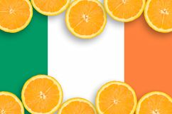 Ireland flag in citrus fruit slices horizontal frame. Ireland flag in horizontal frame of orange citrus fruit slices. Concept of growing as well as import and royalty free stock image