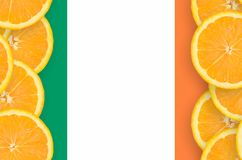 Ireland flag in citrus fruit slices vertical frame. Ireland flag in vertical frame of orange citrus fruit slices. Concept of growing as well as import and export stock photos