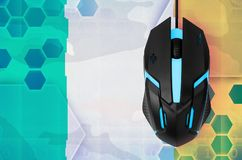 Ireland flag and computer mouse. Concept of country representing e-sports team. Ireland flag and modern backlit computer mouse. Concept of country representing e royalty free stock photography