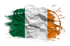 Ireland flag on Crumpled paper texture. Old recycled paper background royalty free stock photo