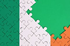 Ireland flag is depicted on a completed jigsaw puzzle with free green copy space on the right side.  royalty free illustration