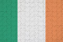 Ireland flag is depicted on a folded puzzle royalty free stock images