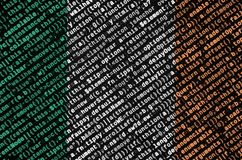 Ireland flag is depicted on the screen with the program code. The concept of modern technology and site development.  stock image
