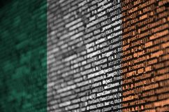 Ireland flag is depicted on the screen with the program code. The concept of modern technology and site development.  stock images