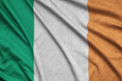 Ireland flag is depicted on a sports cloth fabric with many folds. Sport team banner. Ireland flag is depicted on a sports cloth fabric with many folds. Sport royalty free stock images