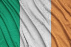 Ireland flag is depicted on a sports cloth fabric with many folds. Sport team banner. Ireland flag is depicted on a sports cloth fabric with many folds. Sport royalty free stock photos