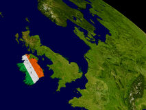 Ireland with flag on Earth Royalty Free Stock Image