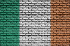 Ireland flag is painted onto an old brick wall stock illustration
