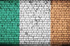 Ireland flag is painted onto an old brick wall stock photo