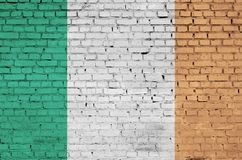 Ireland flag is painted onto an old brick wall vector illustration