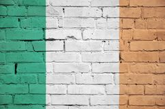 Ireland flag is painted onto an old brick wall stock image