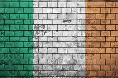 Ireland flag is painted onto an old brick wall royalty free stock image