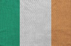 Ireland flag printed on a polyester nylon sportswear mesh fabric. With some folds stock photo