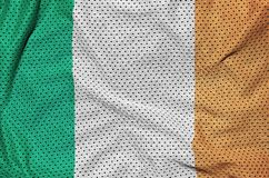 Ireland flag printed on a polyester nylon sportswear mesh fabric. With some folds stock image
