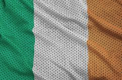Ireland flag printed on a polyester nylon sportswear mesh fabric. With some folds stock photography