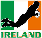 Ireland flag rugby player try dive. Illustration of a silhouette Irish rugby playing diving to score a try with Ireland flag in background Stock Images
