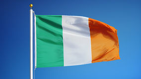 Ireland flag in slow motion seamlessly looped with alpha. Ireland flag waving in slow motion against blue sky, seamlessly looped, close up, isolated on alpha stock video