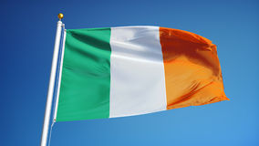 Ireland flag in slow motion seamlessly looped with alpha. Ireland flag waving in slow motion against blue sky, seamlessly looped, close up, isolated on alpha stock footage