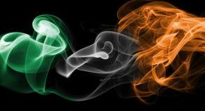 Ireland flag smoke. Isolated on a black background stock photos