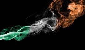 Ireland flag smoke. Isolated on a black background royalty free stock photo
