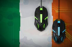 Ireland flag and two mice with backlight. Online cooperative games. Cyber sport team. Ireland flag and two modern computer mice with backlight. The concept of royalty free stock photos