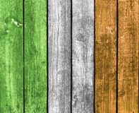 Ireland flag wooden background. Vertical boards with a vertical overlay of the colors green, white and orange representing the flag of Ireland, a St. Patrick's Stock Images