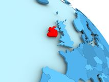 Ireland on blue globe. Ireland highlighted on blue 3D model of political globe. 3D illustration Royalty Free Stock Photos