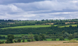 Ireland: landscape. Irish landscape. Green hills, fields, trees and clouds above Royalty Free Stock Images