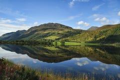 Ireland landscape with reflection. West of ireland landscape, with river, blue sky and reflection Stock Photo