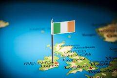 Ireland marked with a flag on the map.  royalty free stock image