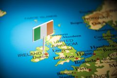 Ireland marked with a flag on the map.  stock photos