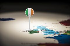 Ireland marked with a flag on the map.  stock photography