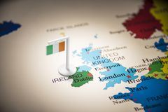 Ireland marked with a flag on the map.  stock images
