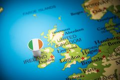 Ireland marked with a flag on the map.  stock photo