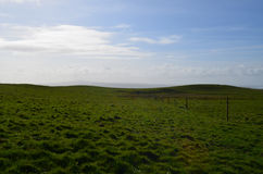 Ireland`s Scenic Hills and Fields in County Clare. Gorgeous grass fields and hills in County Clare Ireland Stock Photos