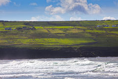 Ireland: sea, land and sky. Cliffs of Doolin's Bay, The Burren, County Clare, Ireland Stock Images