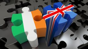 Ireland and United Kingdom flags on puzzle pieces. Political relationship concept. 3D rendering stock illustration