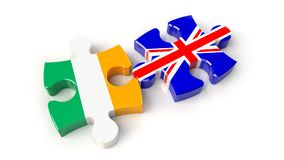 Ireland and United Kingdom flags on puzzle pieces. Political rel Stock Images