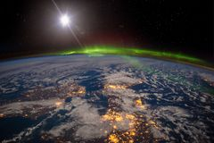 Ireland, United Kingdom and Scandinavia on a moonlit night under an amazing aurora. The elements of this image furnished by NASA royalty free stock images