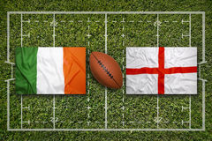 Ireland vs. England flags on rugby field Royalty Free Stock Image