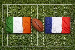 Ireland vs. France flags on rugby field Royalty Free Stock Image