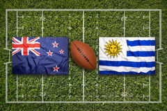 New Zealand vs. Uruguay flags on rugby field Stock Photography