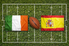 Ireland vs. Spain flags on rugby field Royalty Free Stock Photos