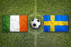 Ireland vs. Sweden flags on soccer field Royalty Free Stock Photography