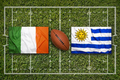 Ireland vs. Uruguay flags on rugby field Stock Photos