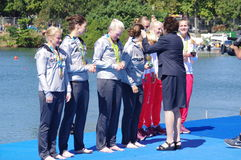 Irena Szewinska gives medals in women's quadruple sculls Rio2016 Royalty Free Stock Photography
