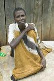 Irene, infected with HIV/AIDS, sits on ground at the Pepo La Tumaini Jangwani, HIV/AIDS Community Rehabilitation Program, Orphanag Stock Image